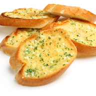 Bread, topped with garlic, herb seasoning, baked to perfection
