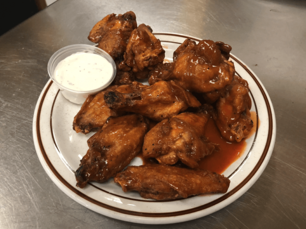 Chicken wings deep-fried, then dipped in hot sauce