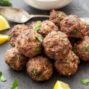 Ground meat rolled into small spheres, prepared with bread crumbs, minced onion, eggs, butter, and seasoning